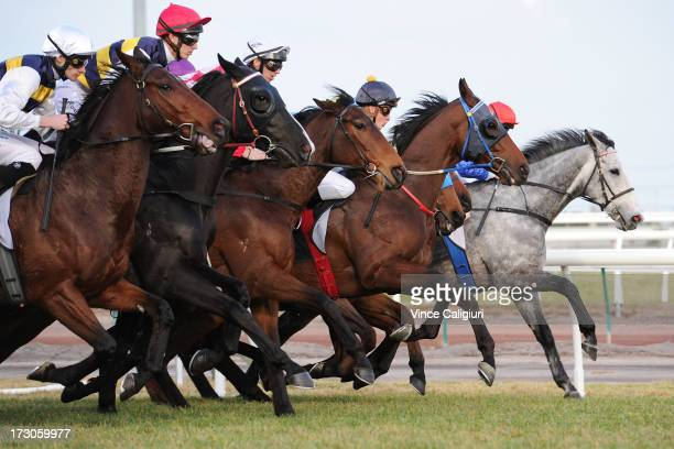 Horses jump out of the starting gates in the Banjo Paterson Series Final during Melbourne racing at Flemington Racecourse on July 6 2013 in Melbourne...