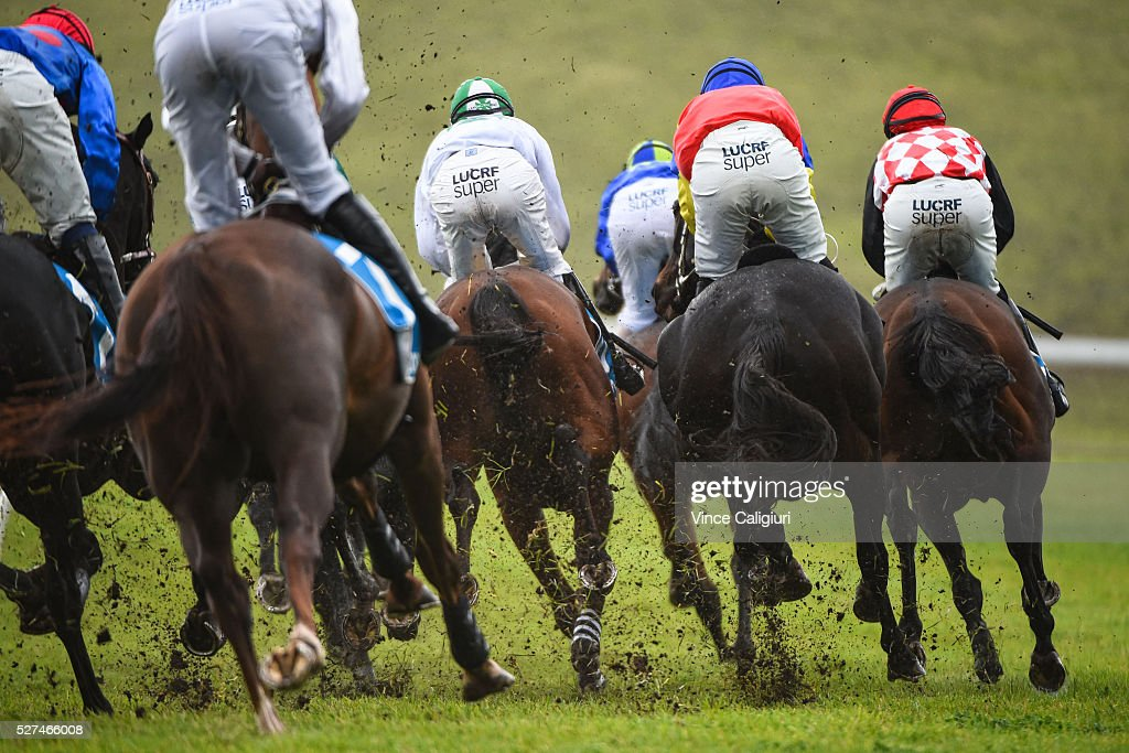 Horses kick up clods of turf as they turn into the home straight in Race 3, the George Taylor Memorial Hurdle during Brierly Day at Warrnambool Race Club on May 3, 2016 in Warrnambool, Australia.