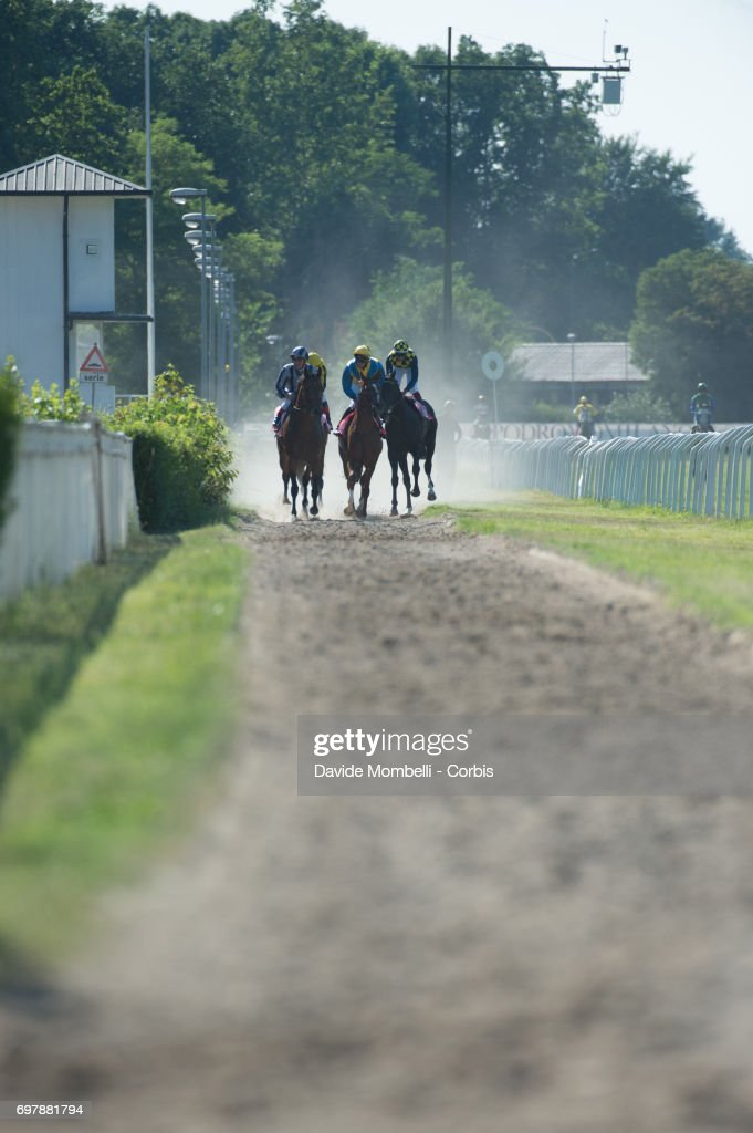 Horses kick up dust after the race won by Dario Vargiu riding Full Drago in the Grand Prix in Milan on June 18, 2017 in Milan, Italy.