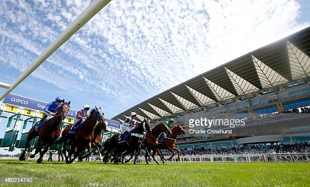 Horses make their way out of the starting stalls to race in The Close Brothers Property Finance Handicap Stakes at Ascot racecourse on July 10 2015...