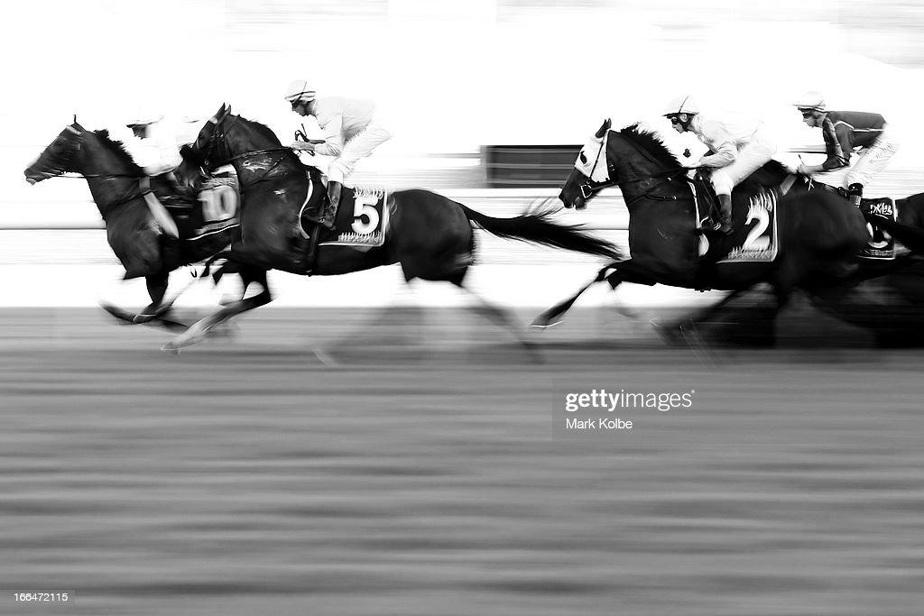 Horses pass during race 7 the David Jones Australian Derby on Australian Derby Day at Royal Randwick Racecourse on April 13, 2013 in Sydney, Australia.