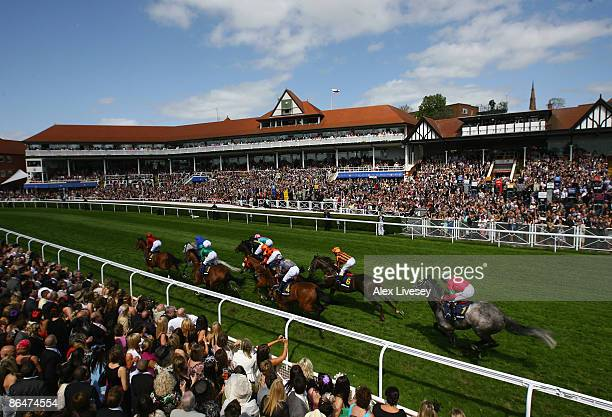 Horses pass in front of the main stand during The extrabetcom Huxley Stakes at Chester Racecourse on May 7 2009 in Chester England