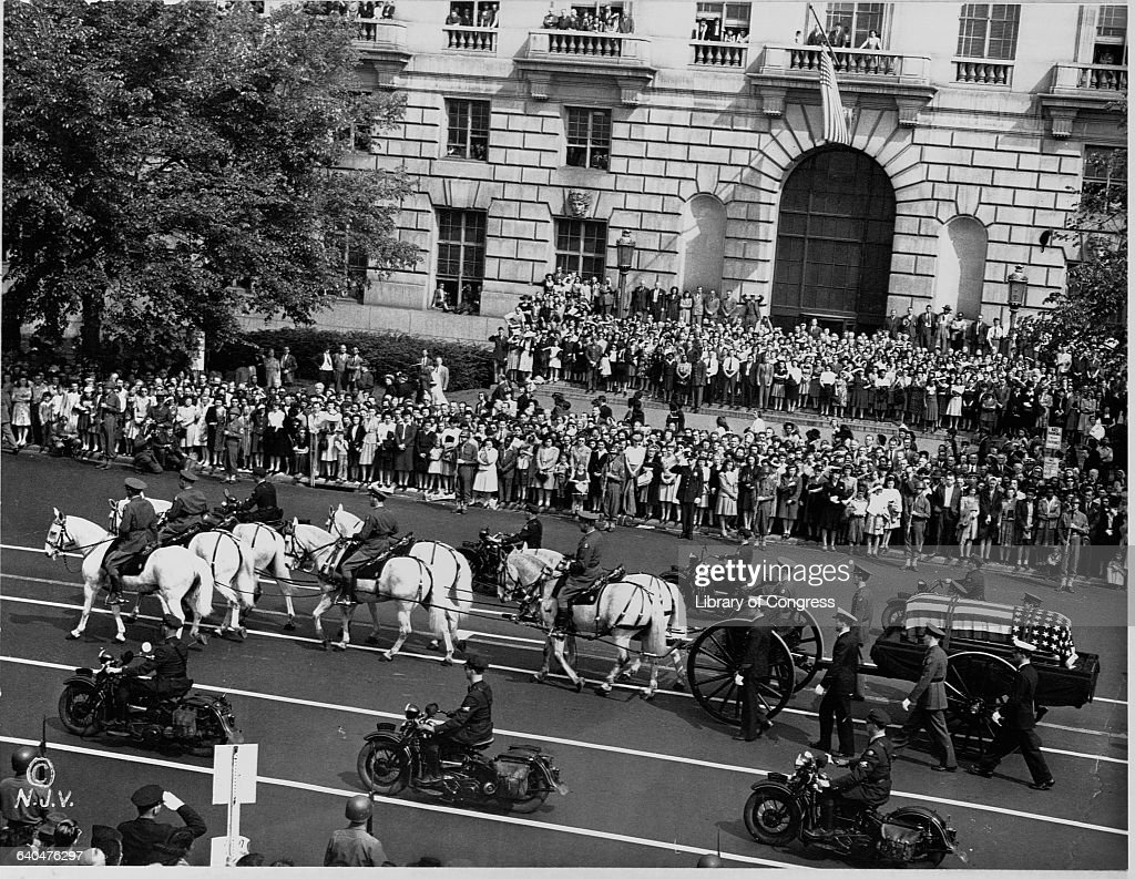 Horses pull a cart carrying the casket of President Franklin Delano Roosevelt down Pennsylvania Avenue
