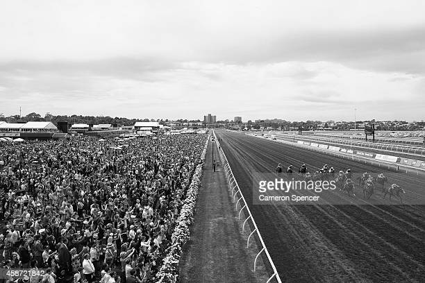 Horses race down the straight during race five on Melbourne Cup Day at Flemington Racecourse on November 4 2014 in Melbourne Australia