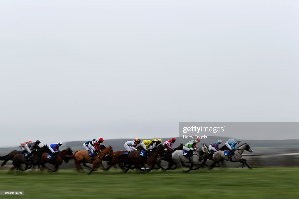 Horses race in the 'At the races sky 415 racing excellence 'Hands and Heels' handicap hurdle race' at Taunton Racecourse on February 7, 2013 in Taunton, England.