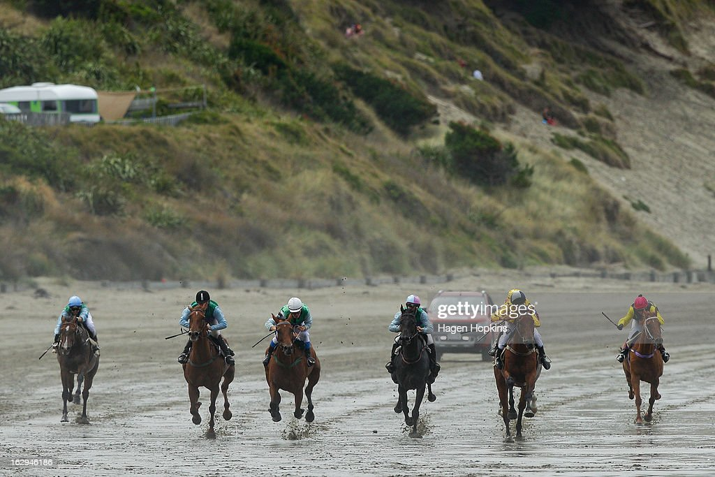 Horses race in the Castlepoint Cup Open during the Castlepoint Beach Races at Castlepoint Beach on March 2, 2013 in Masterton, New Zealand.