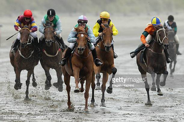 Horses race in the Lighthouse Handicap Open during the Castlepoint Beach Races at Castlepoint Beach on March 2 2013 in Masterton New Zealand