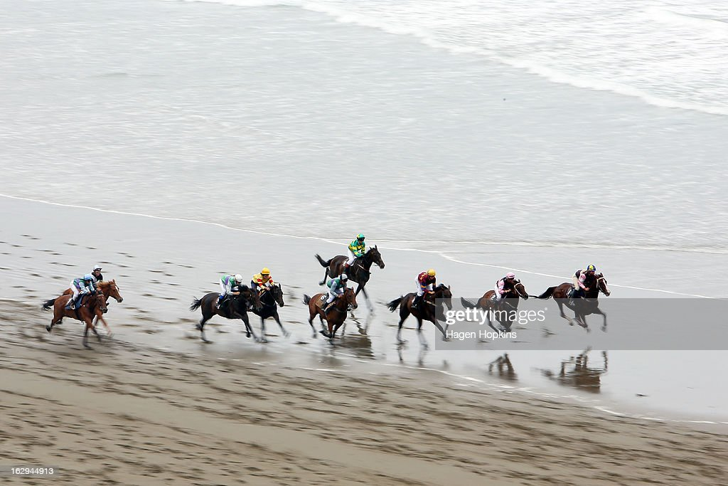 Horses race in the Matakoina Trial Stakes during the Castlepoint Beach Races at Castlepoint Beach on March 2, 2013 in Masterton, New Zealand.