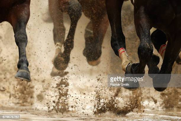 Horses race on a sloppy track prior to the 143rd running of the Kentucky Derby at Churchill Downs on May 6 2017 in Louisville Kentucky