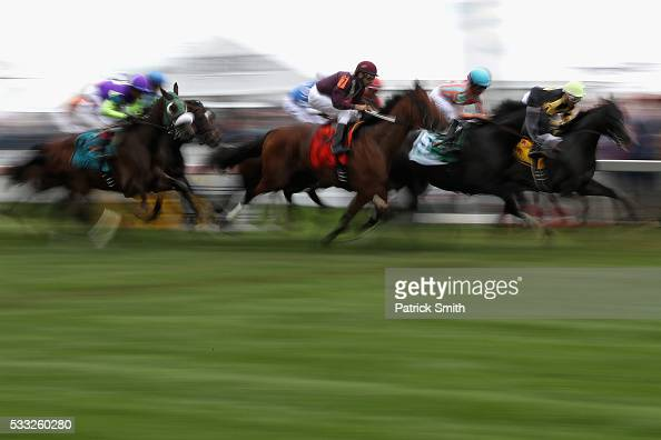 Horses race on turf prior to the 141st running of the Preakness Stakes at Pimlico Race Course on May 21 2016 in Baltimore Maryland