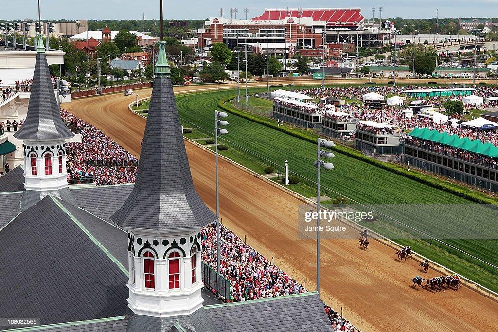 Horses race toward the finish of race #8 on Kentucky Oaks Day at Churchill Downs on May 3, 2013 in Louisville, Kentucky.