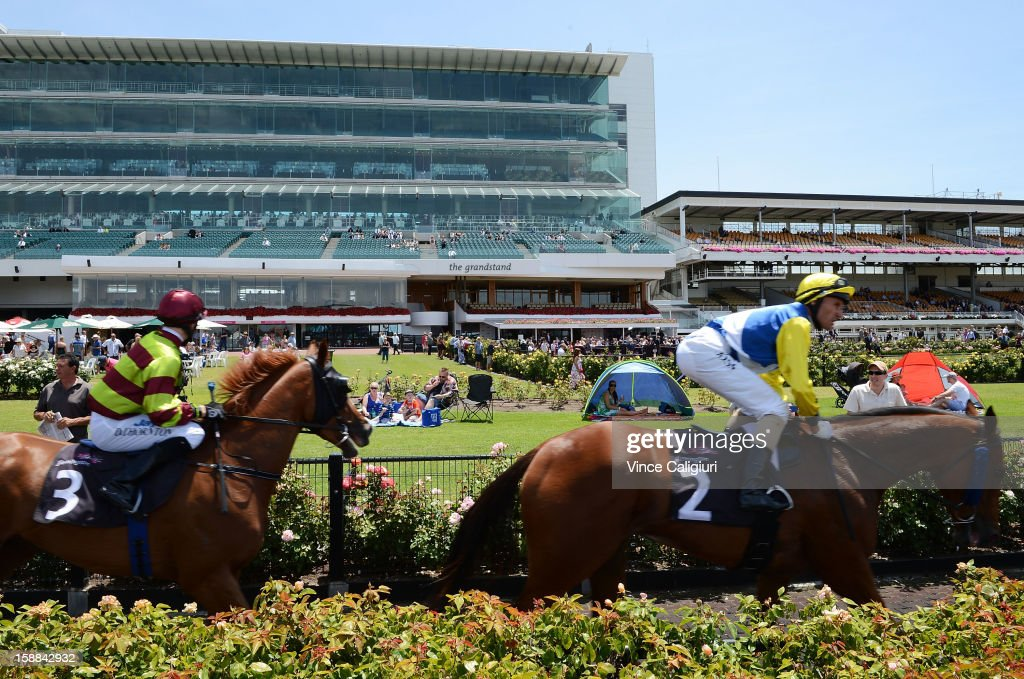 Horses return to mounting yard during Melbourne Racing at Flemington Racecourse on January 1, 2013 in Melbourne, Australia.