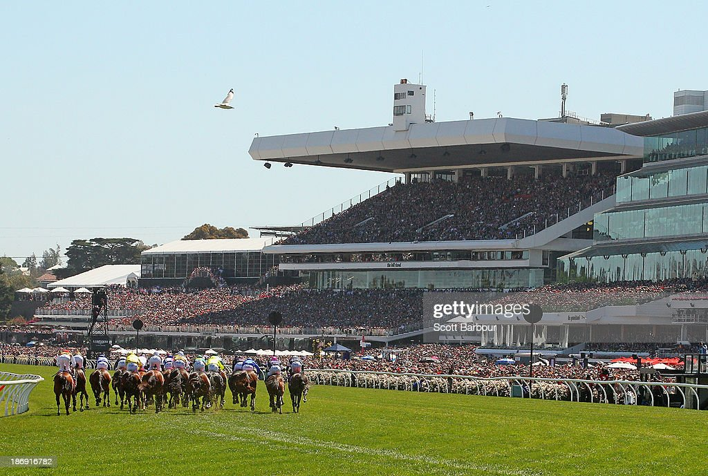 Horses round the final bend during race 7 the Emirates Melbourne Cup during Melbourne Cup Day at Flemington Racecourse on November 5, 2013 in Melbourne, Australia.