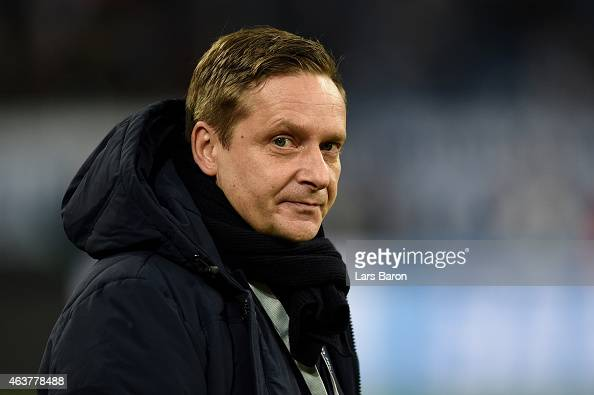 Horst Heldt the Schalke General manager looks on prior to kickoff during the UEFA Champions League Round of 16 match between FC Schalke 04 and Real...