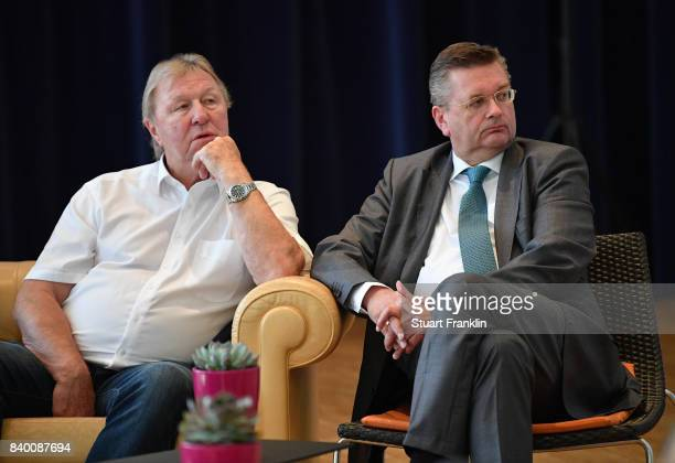 Horst Hrubesch and DFB President Reinhard Grindel look on during the DFB and Bundesliga Coach Forum on August 28 2017 in Hanover Germany
