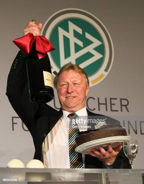 Horst Hrubesch coach of DFB celebrates on the podium during the DFB Live at the Congress Center on April 16 2010 in Hannover Germany