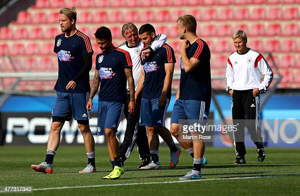 Horst Hrubesch head coach of Germany talks to Kevin Volland during a training session ahead of the EURO 2015 Group A match against Serbia at Letna...