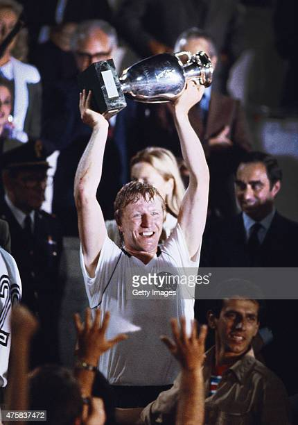 Horst Hrubesch of West Germany lifts the trophy after his two goals had helped defeat Belguim to win the 1980 European Football Championships on June...