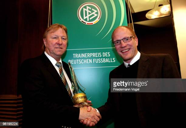 Horst Hrubesch receives the Football Trainer of the year 2009 award from Matthias Sammer at the Inter Conti hotel on April 1 2010 in Cologne Germany