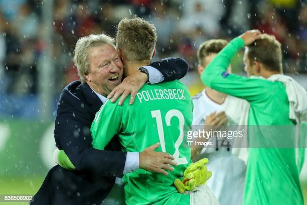 Horst Hrubesch shakes hands with Goalkeeper Julian Pollersbeck of Germany during the UEFA U21 Final match between Germany and Spain at Krakow Stadium...