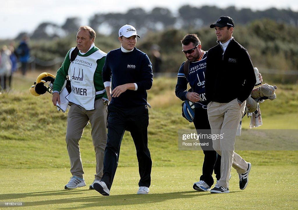 Horst Kaymer, Philp Kaymer and <a gi-track='captionPersonalityLinkClicked' href=/galleries/search?phrase=Martin+Kaymer&family=editorial&specificpeople=2143733 ng-click='$event.stopPropagation()'>Martin Kaymer</a> of Germany during the first round of the 2013 Alfred Dunhill Links Championship at the Carnoustie Golf Links on September 26, 2013 in Carnoustie, Scotland.