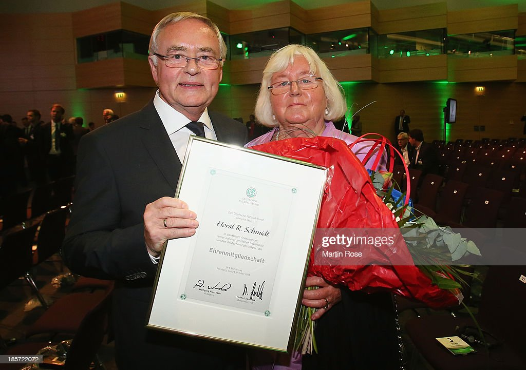 <a gi-track='captionPersonalityLinkClicked' href=/galleries/search?phrase=Horst+R.+Schmidt&family=editorial&specificpeople=585662 ng-click='$event.stopPropagation()'>Horst R. Schmidt</a> (l) poses with his wife Ute Koenig-Schmidt after the DFB Bundestag at NCC Nuremberg on October 24, 2013 in Nuremberg, Germany.
