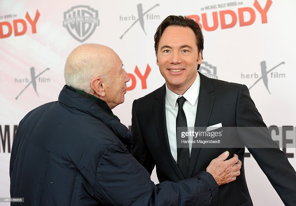 Horst Sachtleben and Michael Bully Herbig attend 'Buddy' Premiere at Mathaeser Filmpalast on December 17, 2013 in Munich, Germany.