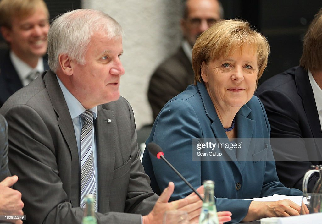<a gi-track='captionPersonalityLinkClicked' href=/galleries/search?phrase=Horst+Seehofer&family=editorial&specificpeople=4273631 ng-click='$event.stopPropagation()'>Horst Seehofer</a> (L), Chairman of the Bavarian Christian Democrats (CSU), and <a gi-track='captionPersonalityLinkClicked' href=/galleries/search?phrase=Angela+Merkel&family=editorial&specificpeople=202161 ng-click='$event.stopPropagation()'>Angela Merkel</a>, German Chancellor and Chairwoman of the German Christian Democrats (CDU), sit down for negotiations with the German Social Democrats (SPD) at the Bavarian state representation on November 5, 2013 in Berlin, Germany. The SPD, CSU and CDU are hashing through policy issues in an effort to create a new German colaition government following elections in September.