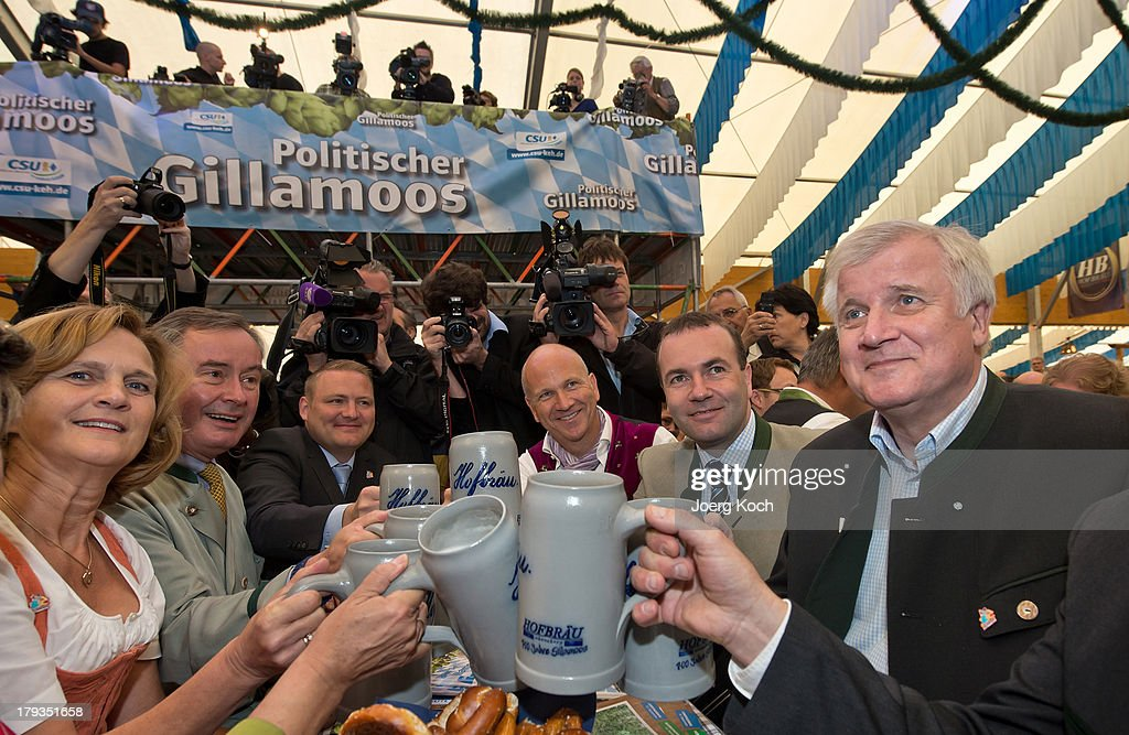 <a gi-track='captionPersonalityLinkClicked' href=/galleries/search?phrase=Horst+Seehofer&family=editorial&specificpeople=4273631 ng-click='$event.stopPropagation()'>Horst Seehofer</a>, Chairman of the Bavarian Christian Democrats (CSU, R), drinks a Mass Beer at the annual Gillamoos beer tent day of politics on September 2, 2013 in Abensberg, Germany. Bavaria is scheduled to hold state elections on September 15, one week ahead of German federal elections scheduled for September 22.