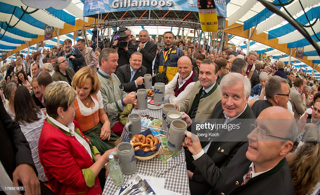 <a gi-track='captionPersonalityLinkClicked' href=/galleries/search?phrase=Horst+Seehofer&family=editorial&specificpeople=4273631 ng-click='$event.stopPropagation()'>Horst Seehofer</a>, Chairman of the Bavarian Christian Democrats (CSU) (2nd R), drinks a Mass Beer at the annual Gillamoos beer tent day of politics on September 2, 2013 in Abensberg, Germany. Bavaria is scheduled to hold state elections on September 15, one week ahead of German federal elections scheduled for September 22.