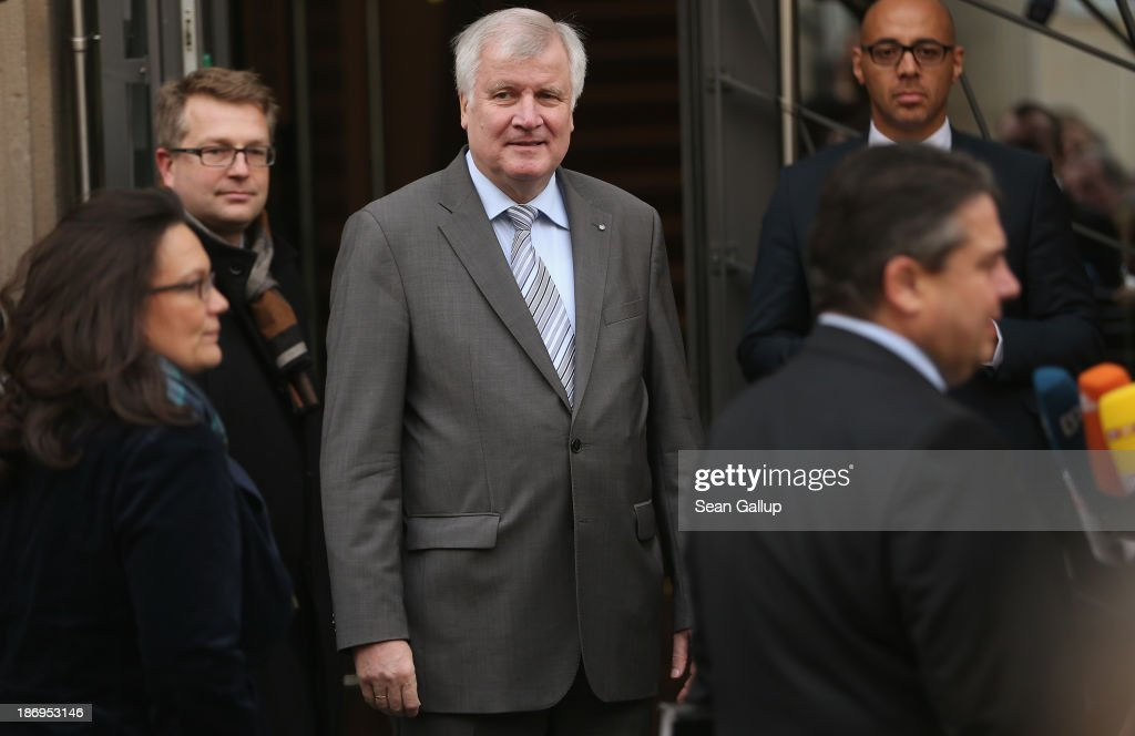 <a gi-track='captionPersonalityLinkClicked' href=/galleries/search?phrase=Horst+Seehofer&family=editorial&specificpeople=4273631 ng-click='$event.stopPropagation()'>Horst Seehofer</a> (C), Chairman of the Bavarian Christian Democrats (CSU), looks on as <a gi-track='captionPersonalityLinkClicked' href=/galleries/search?phrase=Sigmar+Gabriel&family=editorial&specificpeople=543927 ng-click='$event.stopPropagation()'>Sigmar Gabriel</a> (R), Chairman of the German Social Democrats (SPD) and SPD General Secretary <a gi-track='captionPersonalityLinkClicked' href=/galleries/search?phrase=Andrea+Nahles&family=editorial&specificpeople=822618 ng-click='$event.stopPropagation()'>Andrea Nahles</a> arrive at the Bavarian state representation for coalition negotiations on November 5, 2013 in Berlin, Germany. The SPD, CSU and German Christian Democrats (CDU) are hashing through policy issues in an effort to create a new German colaition government following elections in September.