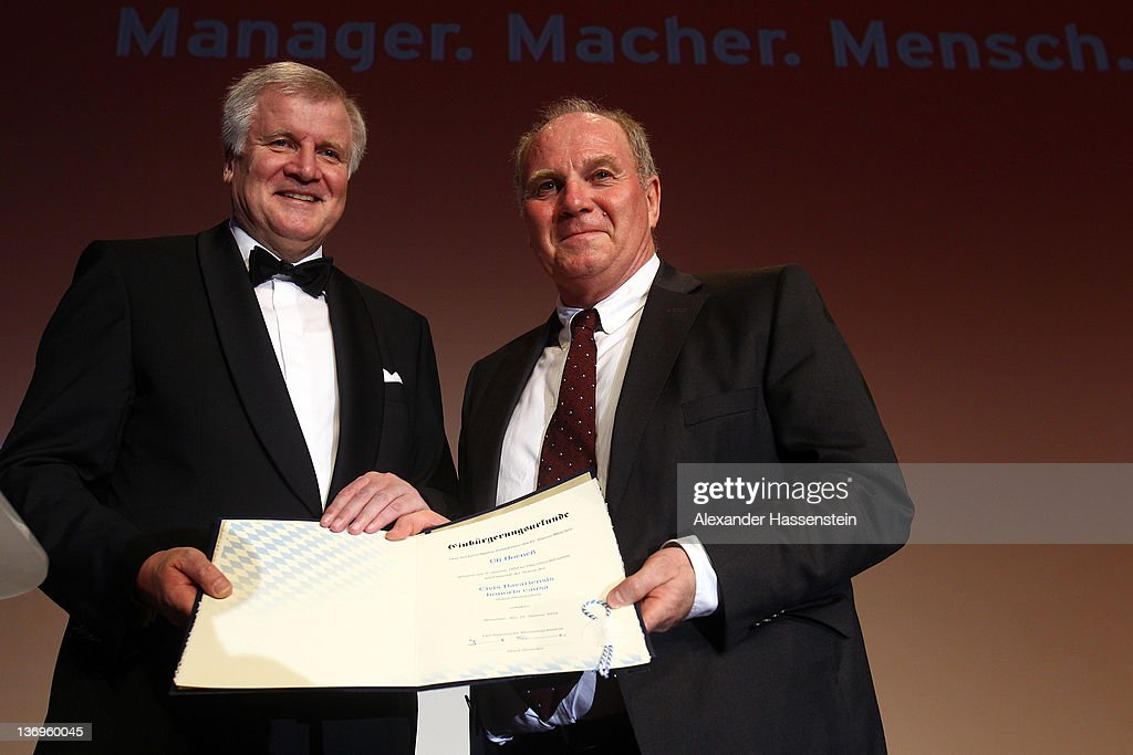 <a gi-track='captionPersonalityLinkClicked' href=/galleries/search?phrase=Horst+Seehofer&family=editorial&specificpeople=4273631 ng-click='$event.stopPropagation()'>Horst Seehofer</a>, Chairman of the Christian Social Union (CSU), hands over a Bavarian certificate of naturalization to <a gi-track='captionPersonalityLinkClicked' href=/galleries/search?phrase=Uli+Hoeness&family=editorial&specificpeople=634868 ng-click='$event.stopPropagation()'>Uli Hoeness</a> at <a gi-track='captionPersonalityLinkClicked' href=/galleries/search?phrase=Uli+Hoeness&family=editorial&specificpeople=634868 ng-click='$event.stopPropagation()'>Uli Hoeness</a>' 60th birthday celebration at Postpalast on January 13, 2012 in Munich, Germany.