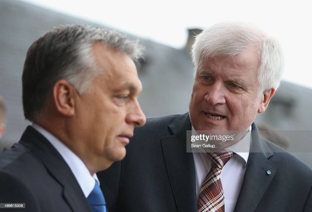 <a gi-track='captionPersonalityLinkClicked' href=/galleries/search?phrase=Horst+Seehofer&family=editorial&specificpeople=4273631 ng-click='$event.stopPropagation()'>Horst Seehofer</a> (R), Governor of Bavaria and head of the Bavarian Christian Democrats (CSU), chats with <a gi-track='captionPersonalityLinkClicked' href=/galleries/search?phrase=Viktor+Orban&family=editorial&specificpeople=4685765 ng-click='$event.stopPropagation()'>Viktor Orban</a>, Prime Minister of Hungary, upon Orban's arrival at a four-day meeting of the CSU Bavarian parliamentary faction at Kloster Banz on September 23, 2015 in Bad Staffelstein, Germany. Seehofer invited Orban to participate in today's discussion in which refugee policy and immigration will be prominent. Orban has pursued a rigid course against migrants and refugees seeking to enter Hungary by building a fence along the country's border to Serbia. Orban will travel to Brussels for an EU summit on refugee policy later today.