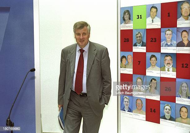 Horst SEEHOFER member of the federal parliament in the KonradAdenauerHaus in front of a board with portraits of various citizens and their proCDU/CSU...