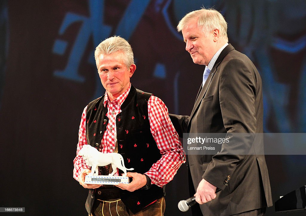 Horst Seehofer (R), Minister-President of Bavaria, hands over a white lion, a prize of the state of Bavaria, to Jupp Heynckes, head coach of Bayern Muenchen, during the Official Champion dinner of Bayern Muenchen at Postpalast on May 12, 2013 in Munich, Germany.