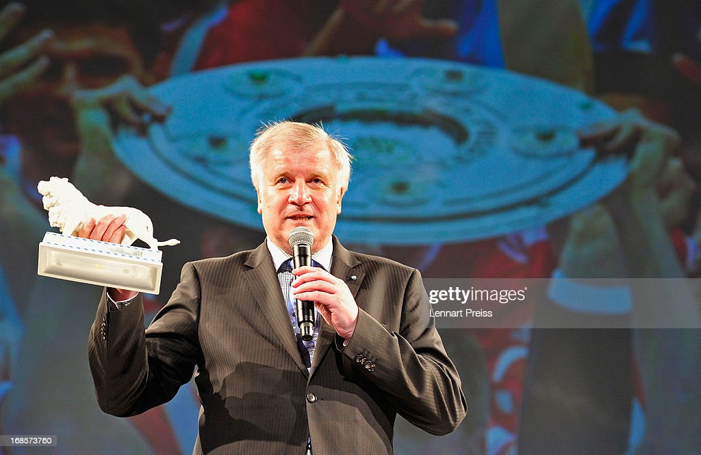 Horst Seehofer, Minister-President of Bavaria, holds a white lion, a prize of the state of Bavaria, during the Official Champion dinner of Bayern Muenchen at Postpalast on May 12, 2013 in Munich, Germany.