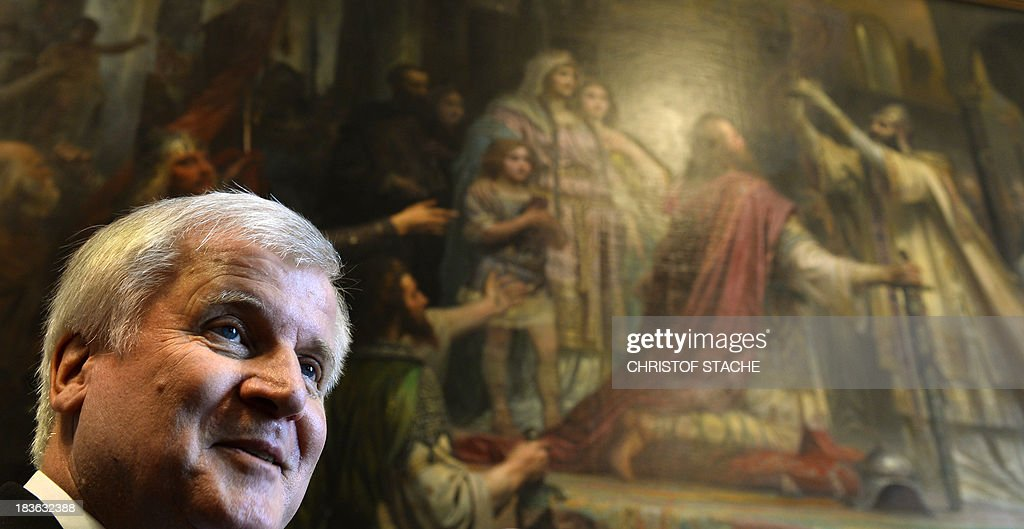 Horst Seehofer stands in front of a painting showing the coronation of Charlemagne after his re-elected as Bavarian State Premier at the Bavarian State Parliament in Munich, southern Germany, on October 8, 2013. Three weeks after regional elections in Bavaria, Seehofer of the conservative Christian Social Union (CSU) party was appointed State Premier of the southern federal state for another five years.