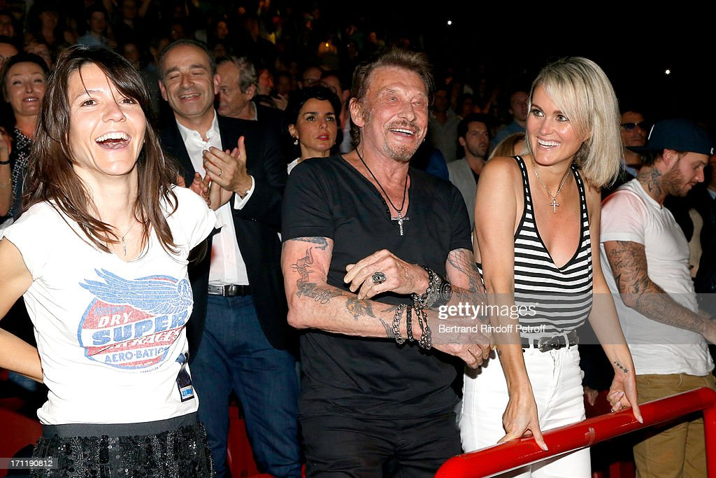 Hortense d'Esteve, Singer Johnny Hallyday and his wife Laeticia Hallyday in the stand while Patrick Bruel performs at his last concert in Paris, held at Palais Omnisports de Bercy on June 22, 2013 in Paris, France.