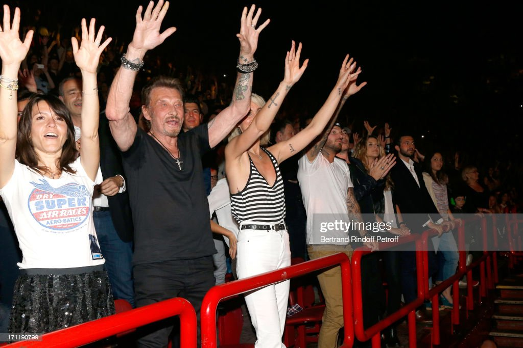 Hortense d'Esteve, Singer Johnny Hallyday with his wife Laeticia Hallyday and Matt Pokora in the stand while Patrick Bruel performs at his last concert in Paris, held at Palais Omnisports de Bercy on June 22, 2013 in Paris, France.
