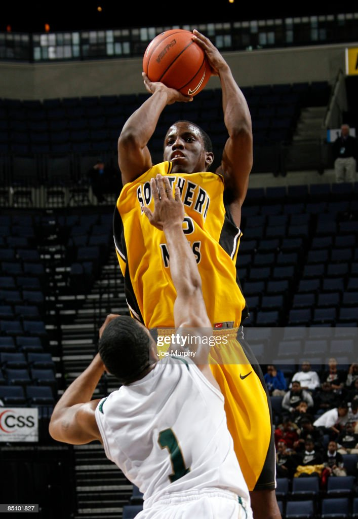 L Horton of the Southern Miss Golden Eagles shoots a jumpshot over Aaron Johnson of the UAB Blazers during the Quarterfinals of the Conference USA...