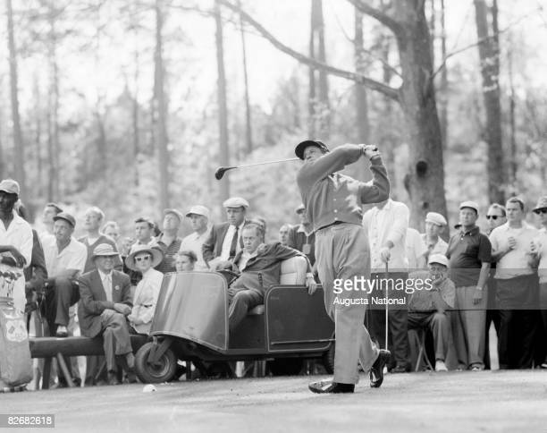 Horton Smith tees off as Bobby Jones watches during the 1956 Masters Tournament at Augusta National Golf Club in April 1956 in Augusta Georgia
