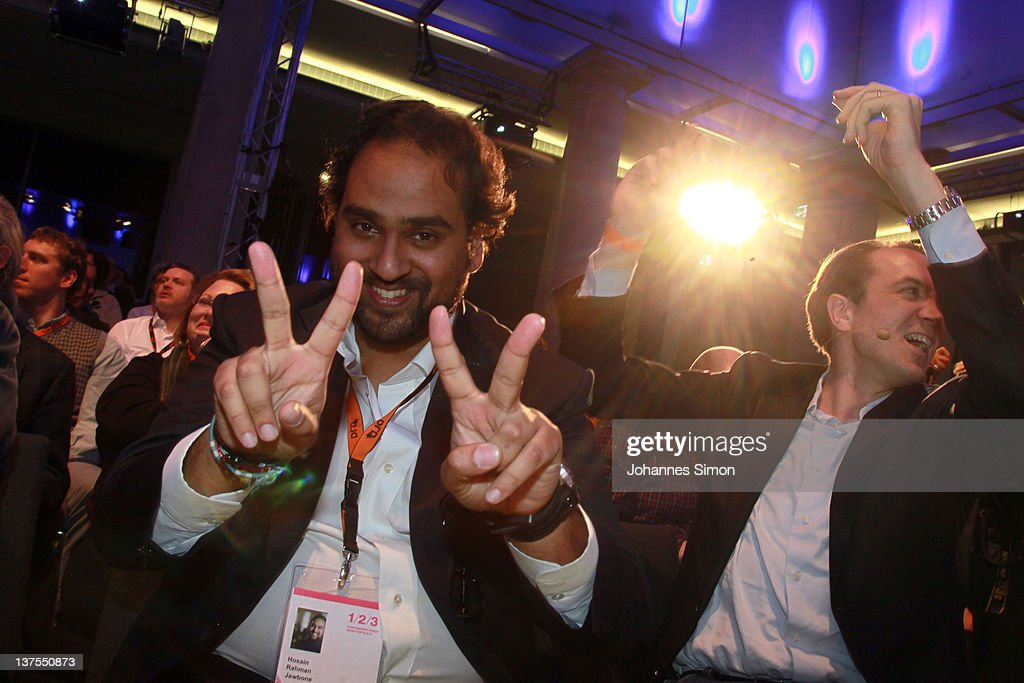 Hosain Rahman of Jawbones an DLD founder Marcel Reichart dance during the Digital Life Design conference (DLD) at HVB Forum on January 22, 2012 in Munich, Germany. DLD (Digital - Life - Design) is a global conference network on innovation, digital, science and culture which connects business, creative and social leaders, opinion-formers and investors for crossover conversation and inspiration.