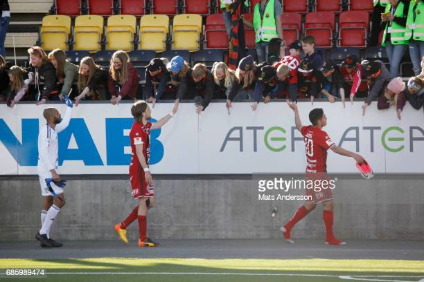 Hosam Aiesh Tom Pettersson and Aly Keita goalkeeper of Ostersunds FK celebrates after the victory of the Allsvenskan match between Ostersunds FK and...