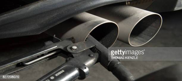 A hose for an emission test is fixed in the exhaust pipe of a Volkswagen Golf 20 litre diesel car at the Technical Inspection Agency in Ludwigsburg...