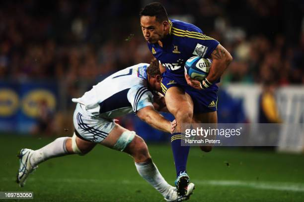 Hosea Gear of the Highlanders charges over to score a try during the round 16 Super Rugby match between the Highlanders and the Blues at Forsyth Barr...