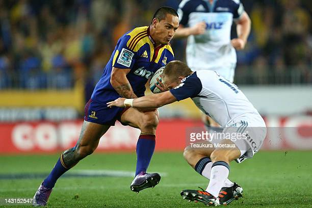 Hosea Gear of the Highlanders is challenged during the round nine Super Rugby match between the Highlanders and the Blues at Forsyth Barr Stadium on...