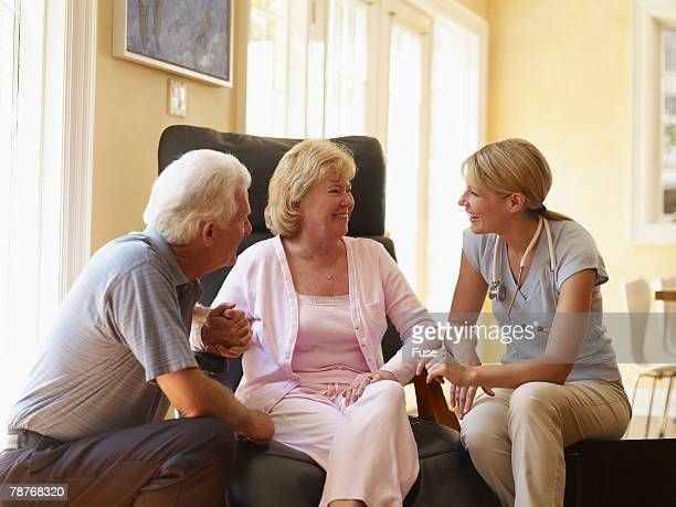 Hospice Nurse Talking to Couple