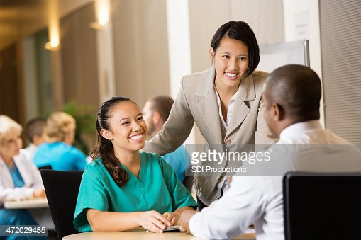 Hospital administrator interviewing nurse for potential employment