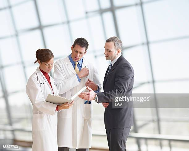 Hospital Administrator Meeting with Doctors