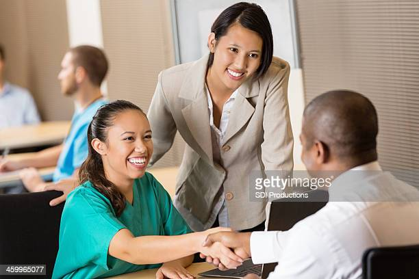 Hospital administrators conducting interview at job fair